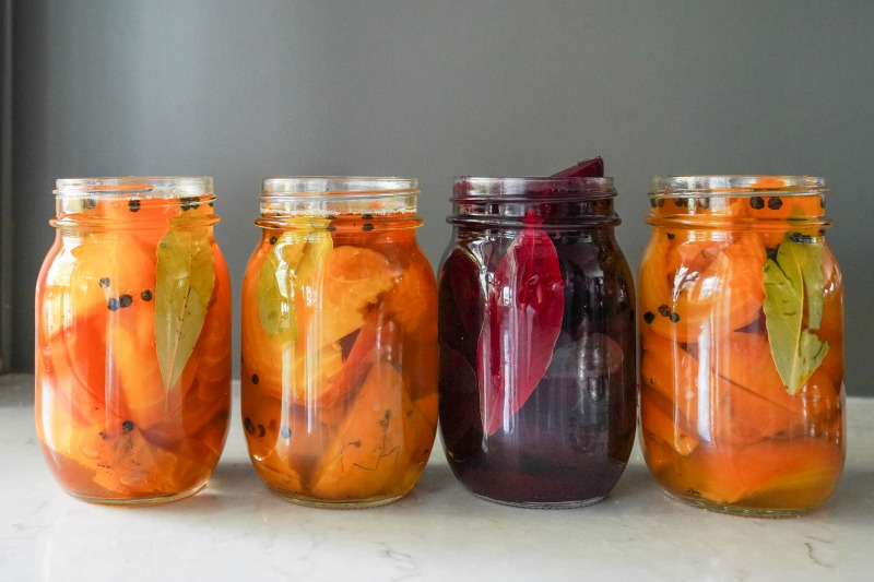 Four mason jars filled with colorful beets. Sharing an easy recipe for quick pickled beets. www.mountainmamacooks.com