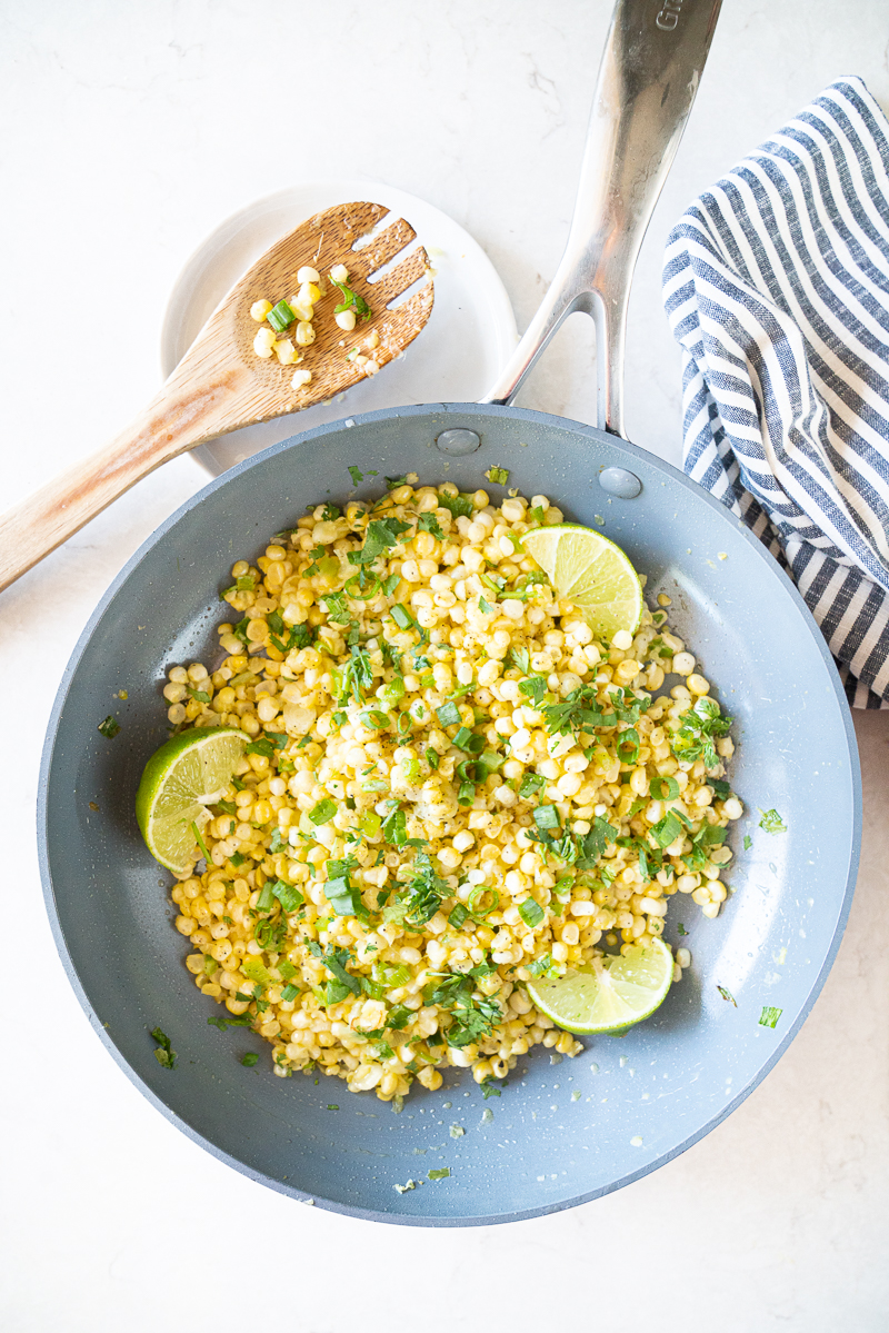 A simple saute of fresh corn, jalapeños, garlic, ginger, scallions and fresh herbs. Finished with lime, this dish is ready in under 10 minutes and is gorgeous in color and taste! www.mountainmamacooks.com