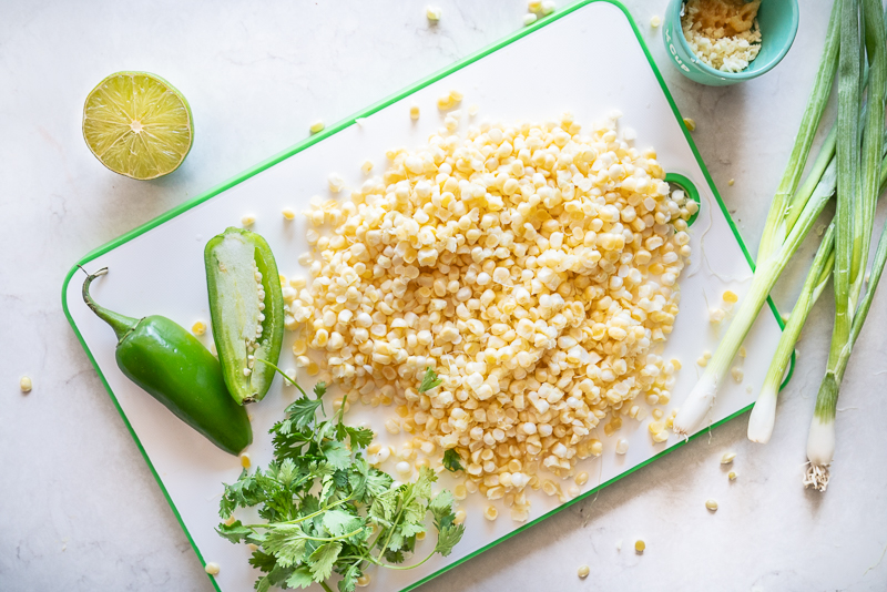 Ingredients for a simple corn side dish: corn, jalapeño, scallions, ginger and garlic. www.mountainmamacooks.com