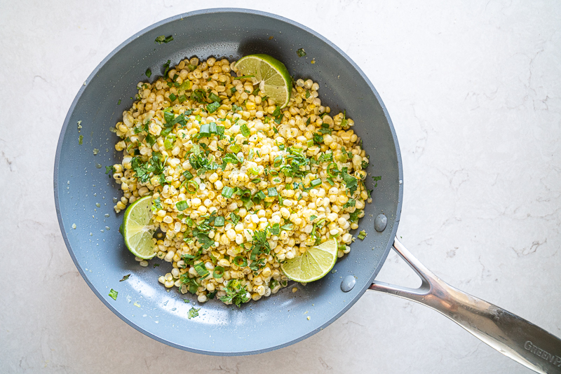 A simple summer side dish of fresh corn kernels, herbs, ginger, garlic and lime. Sautéed just until warm. www.mountainmamacooks.com