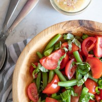 A simple green bean and tomato salad with a shallot vinaigrette and basil. www.mountainmamacooks.com