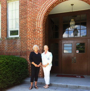 Alumni Joan Montgomery and Shelby Mengel in front of the old Lewisburg High School building