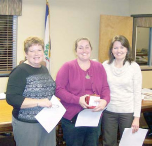 Shane Hanna (center) with Secondary Education Director Deborah White and Technology Director Vicky Cline