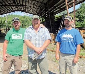 New River Community and Technical College welders Thomas Legg (left), Brad Veneri and Zach Amon will be featured in the Portable Container Cabin episode of the television series Barnwood Builders