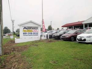 """On July 1, the new Mountaineer Automotive Pre-owned dealership opened on Route 219 north of Lewisburg. This is the previous location of the old John W. Eye """"Big Sandy Superstore."""" There are over 75 handpicked vehicles in the inventory and on pristine display outside while major renovations are going on inside to prepare for a soon to be announced grand opening. Finance Manager Matt Harrah says the massive indoor showroom will be spectacular once the renovations are complete. Mountaineer will also be dealing in new Mitsubishi cars and currently has 15 of them on the lot. (Photo by David Esteppe)"""