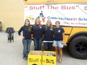 "WVSOM's Delta Omega ""Women in Medicine"" Club representatives dropping off supplies for Stuff the Bus in 2014."