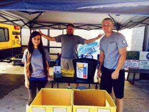 Rainelle Energy Express staff volunteering for Communities In Schools' annual STUFF THE BUS school supply drive.