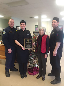 """An Award of Appreciation was presented to Tammy Jordan, owner and president of Fruits of Labor Cafe and Bakery, and Roy W. Lynch, III, executive chef and culinary instructor at Fruits of Labor for their dedication, devotion and commitment to the Rainelle community by the Rainelle Police Chief JP Stevens and Mayor Andy Pendleton, representing the Town of Rainelle on Dec. 23. Fruits of Labor's Seeds of Recovery Culinary program was created to help those in the Greenbrier County Drug Court overcome addiction and substance abuse by training participants in nutrition, agriculture and the culinary arts. """"You have committed yourself to helping those in need,"""" Pendleton said during the presentation. """"The program has proven to be a great success."""" Pictured: Rainelle Police Chief JP Stevens; Tammy Jordan, president at Fruits of Labor; Rainelle Mayor Andy Pendleton and Roy W. Lynch, III, CEC, executive chef and lead culinary instructor at Fruits of Labor, Inc."""