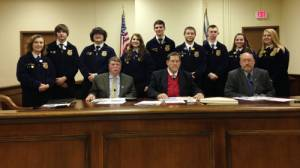 Pictured are members of the Greenbrier East High School FFA program at the Greenbrier County Commission meeting held on Tuesday in honor of FFA Week Feb. 20 to 27: Back Row: Kayelin Perry (left), Andrew Vance, Justin Viers, Savannah Honaker, John McCutcheon, Justin Massey, Erik Ford, Gillian Plaugher and Madison Jackson, along with Commissioner Hanna, Commissioner McClung and Commissioner Rose (seated).