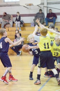 Jacob Nutter, #3, from Quinwood, looks for help from Damian Dixon, #14, from Meadow Bridge, in a rec league game between their Western Greenbrier travel team and the travel team from Frankford. For Frankford, Zach Reed, #11, Dawson Trusty, #13, and Calvin Roberts, #12, are applying the pressure. The game was played Saturday, Feb. 13, in Frankford. (Mark Robinson photo)