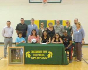 Bella Coles carried on the Coles family athletic tradition last week when she signed on to play volleyball at Wesleyan. Front Row: Bali Coles (left), Weslea Coles, Bella Coles, Bailee Coles and Bimbo Coles; Back Row: Assistant Softball Coach Aaron Ambler (left), Softball Coach Matt Lemons, friends Jared Morgan and Madi Persinger, grandmother Connie Reeves, Sgt. Major Jerry Long, Coach Ali Curry, Volleyball Coach Matt Sauvage and friend Alinda Perrine.