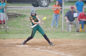 Haylee Shires, pitcher for Greenbrier East, blasts a home run over the right-center fence in the third inning of game at Alleghany High School, Wednesday, Apr. 27. (Mark Robinson photo)