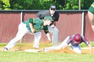 In the third inning of East's game at Woodrow Wilson, Joey Powell tags out runner Cameron Lane at third base. Woodrow Wilson won the game, 1-0. (Mark Robinson photo)