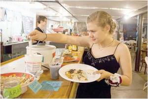 Mabel Eisenbeiss enjoys some pancakes after prom.