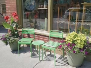 Harmony Ridge Gallery in downtown Lewisburg shows off 2016 Lewisburg in Bloom color scheme of purple, orange and lime green