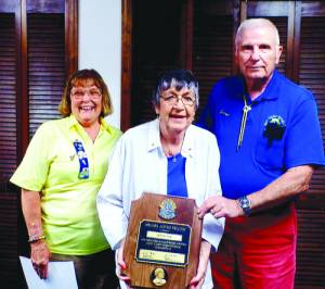 White Sulphur Springs Lion Joyce Poe (middle) was presented a Melvin Jones Fellowship recently by outgoing President Connie McMichael and Past District Governor George Gillespie.