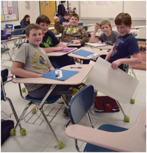 Cyrus Riffle (front), Elijah Perkins, Damien Perry, Kaden McMillion and Logan Osborne collaborate to define their project.