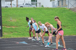 Half a dozen members of the girls soccer team at Greenbrier East line up to start a one-mile run Monday morning. (Mark Robinson photo)