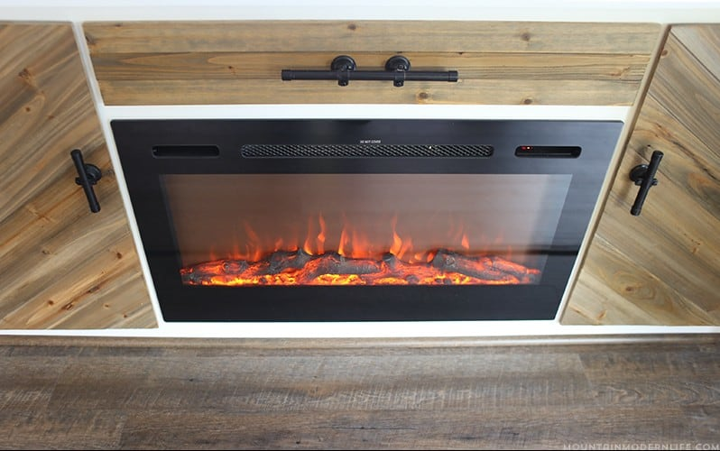 Looking for a creative way to hide your TV? Check out our rustic modern cabinet with TV lift and electric fireplace! MountainModernLife.com