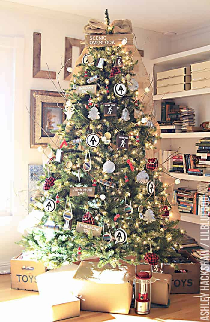 25 of the Most Inspiring Rustic Christmas Trees - Vintage Camping Theme Christmas Tree | LilBlueBoo
