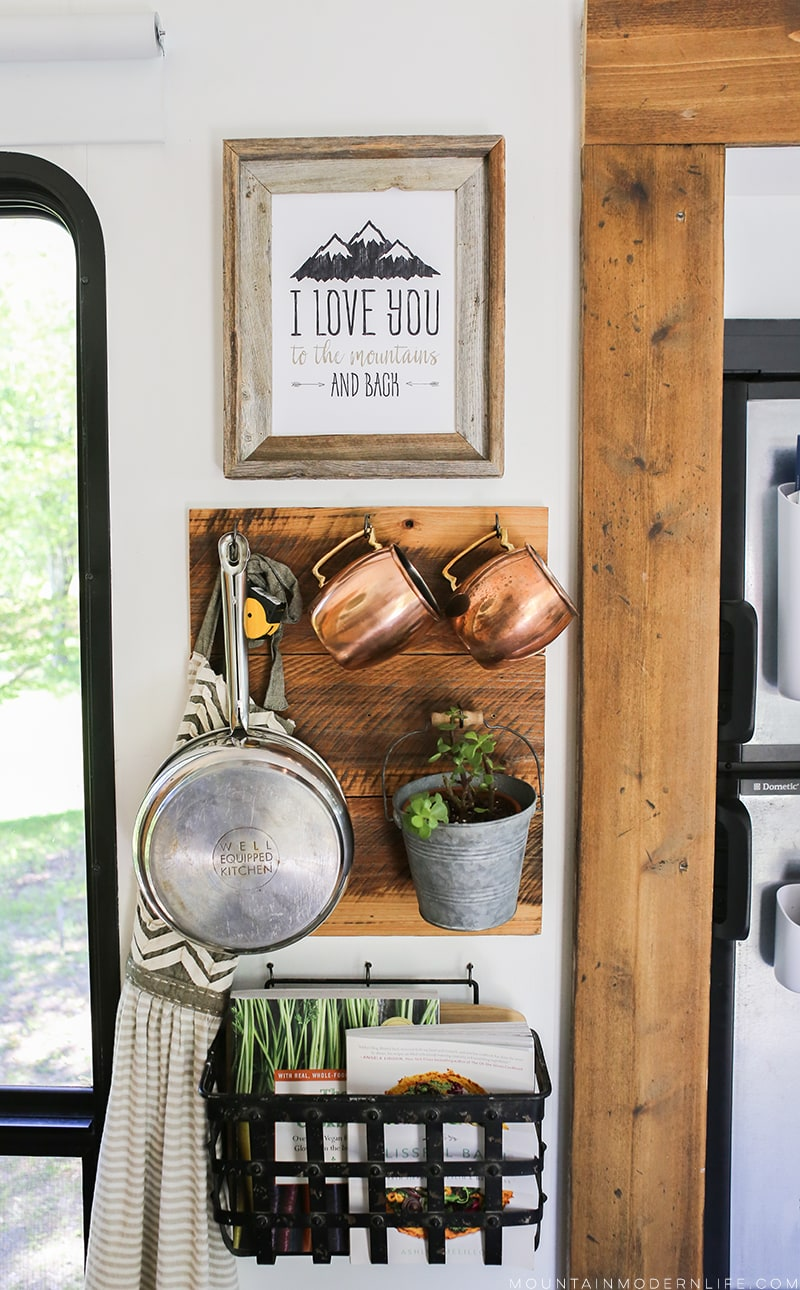 Looking for ways to easily hang frames without using screws or nails? Check out our favorite way to hang wall decor in the RV! MountainModernLife.com