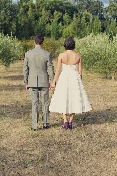 rustic bride and groom pose with their backs to the camera