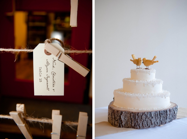 rustic wedding cake with wooden round and bird topper