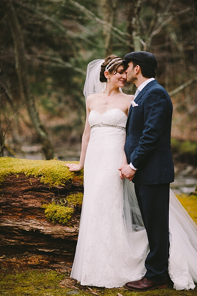 NY mountai bride and groom embrace