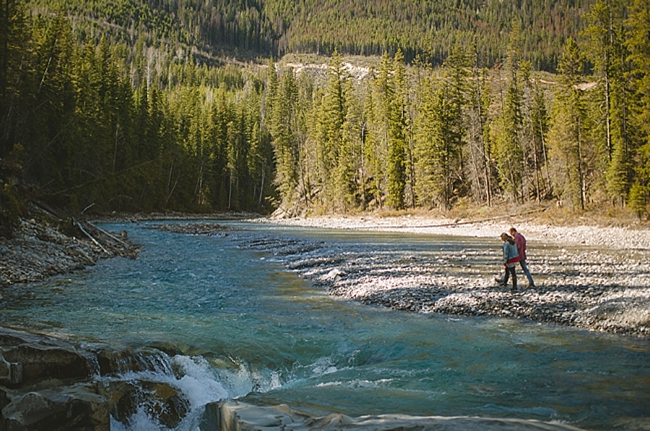 British columbia couple by a river at a mountain engagement shoot by Nordica Photography