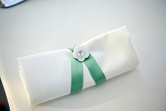 white purse with mint ribbon