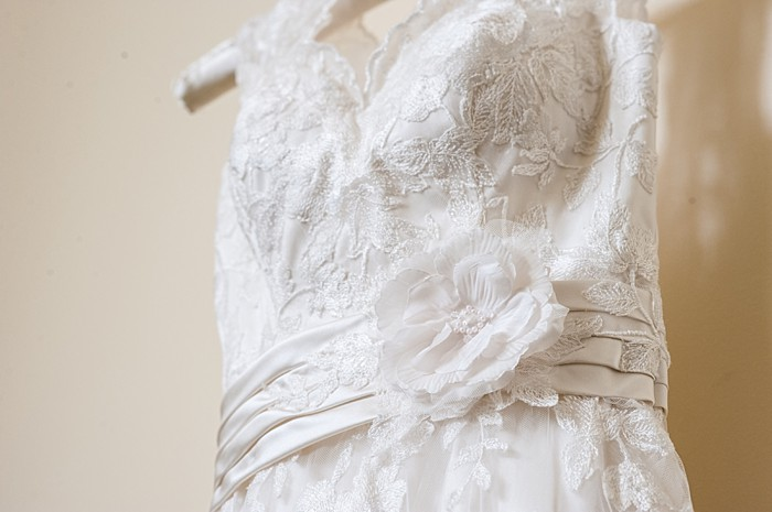 pretty wedding dress with fabric flower belt| Photography by AMW Studios | see more on MountainsideBride.com