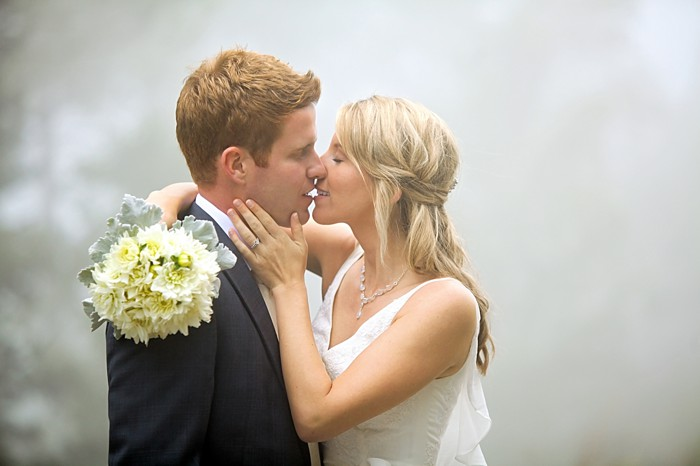 bride and groom kiss in the fog | Snowbird Utah Wedding Logan Walker Photography
