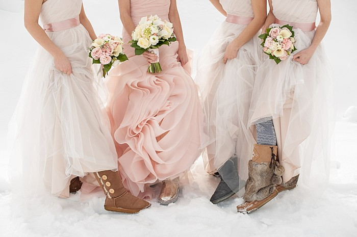 pink wedding gown with white bridesmaids dresses | Lake Louise winter wedding | Orange Girl photography