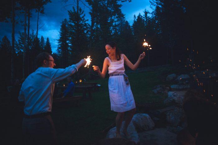29 Wedding Sparklers Sandpoint Idaho Mountain Wedding Amy Galbraith Photography   Via MountainsideBride.com