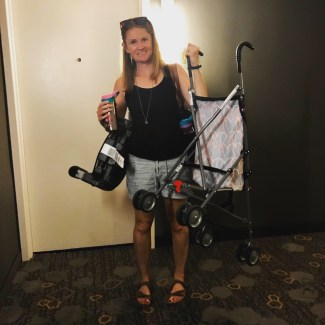 Mom traveling with kids juggling stroller, purse, and car seat via Ashley Stevens at Mountains Unmoved