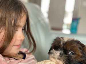 Little girl holding puppy - How God is Present in the sorrows of life via Ashley Stevens at Mountains Unmoved