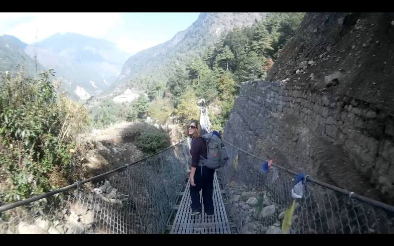 On a suspension bridge in the Everest region with my pack