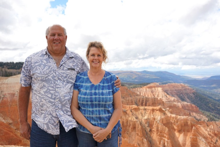 My parents in front of a red rocks overlook at Cedar Breaks National Monument