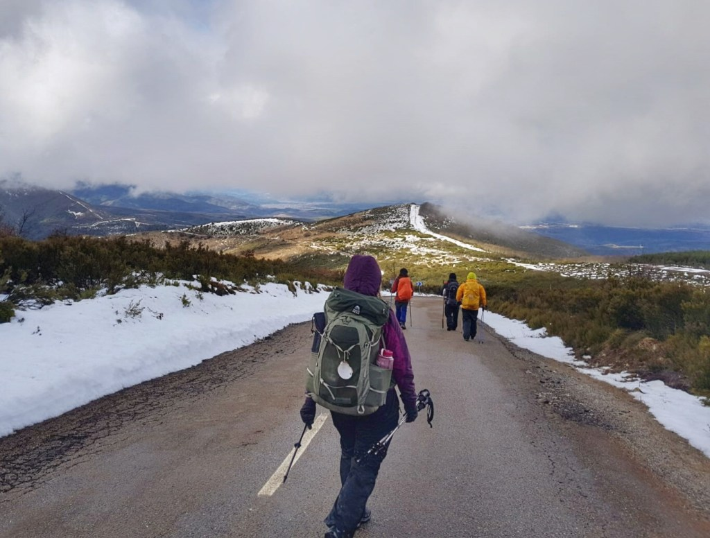 Winter camino de santiago pilgrims hiking down the road