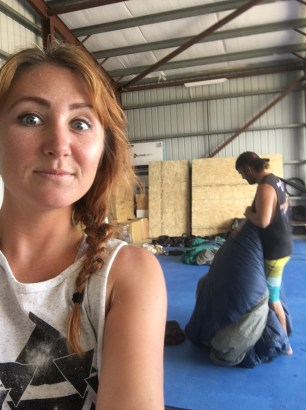 Me being silly while Rocky works in the hangar at Skydive San Pedro