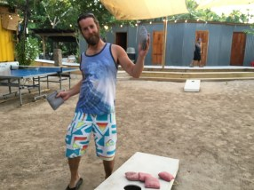Rocky playing corn hole and being silly at The Truck Stop in Ambergris Caye Belize