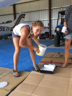 Jess painting the big sign for Skydive San Pedro's hangar