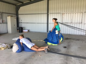 Christina and Jess packing parachutes at the 2017 Fly In at Spanish Lookout Belize