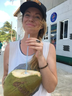 Mandy enjoying fresh coconut water in Caye Caulker