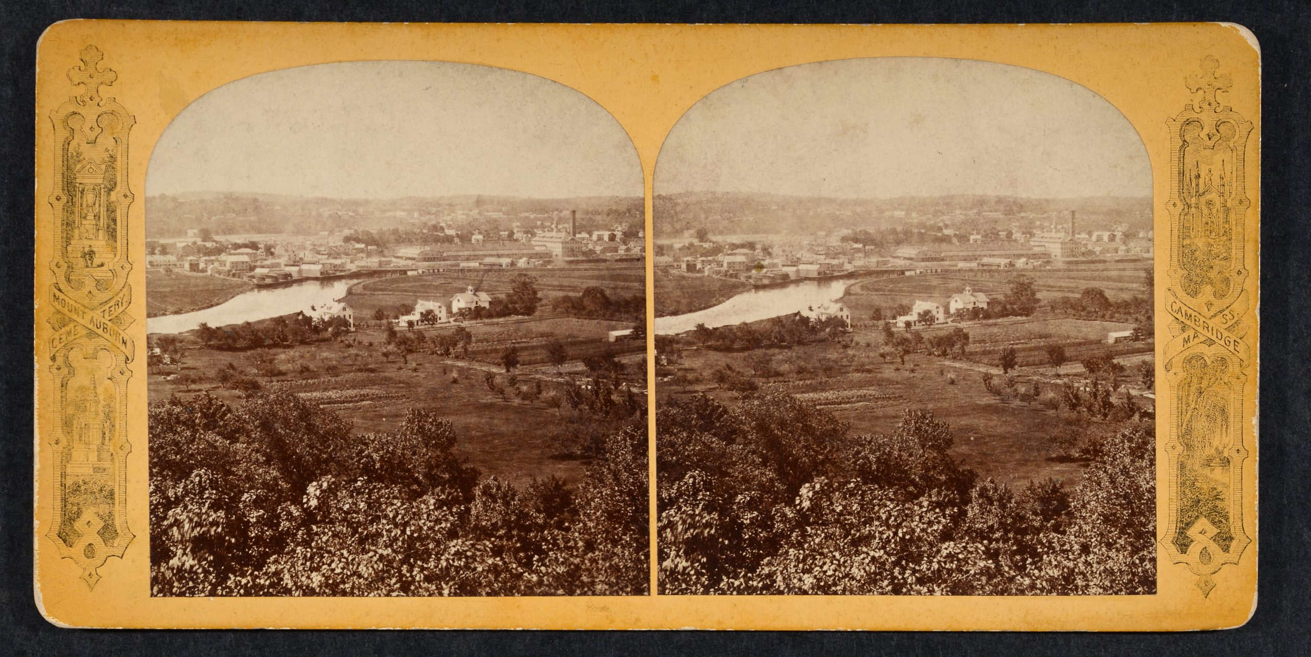 Stereoview of trees, fields, farms, and river with buildings in distance.