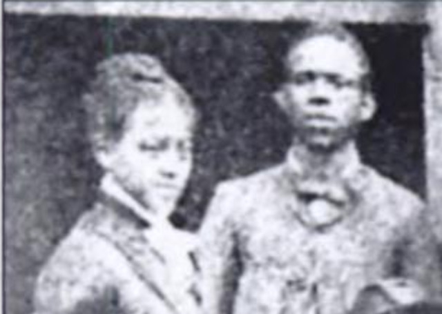 A candid black and white photograph of Gertrude and Clement Morgan. The couple appear young in the image.