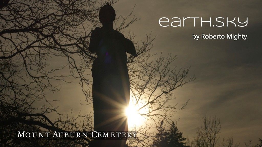 Poster image for earth.sky exhibit shows a marble statue in shadow with light rays from sun streaking the sky.