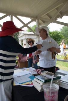 Volunteers learn where they will find veterans in the cemetery.