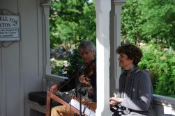 George West and Starr Mitchell of Lark in the Morning provide musical background