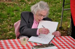 Long-time Association member Mary Fletcher Worthen autographs a copy of Mount Holly's cookbook, Recipes in Perpetuity at the 2010 Spring Picnic
